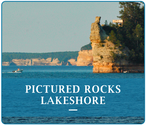 The Pictured Rocks Lakeshore have been naturally sculptured by wind, waves and rain into caves, arches, formations that resemble castle turrets, and human profiles, among others.