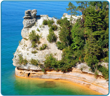 Miners Castle is located 6 1/2 miles east of Munising on Alger County Road H58.