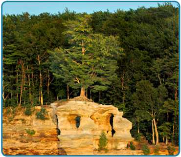 Chapel Rock is located 15 miles east of Munising off Alger County Road H-58, then about 5 miles north to the end of Chapel Road, then there is a 2 1/2 mile hike to this beautiful formation.